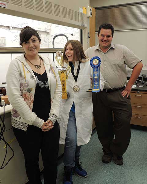 Caylee Hill, center, with FGCU student Jessica Yazarians and Assistant Professor Gregory Boyce.