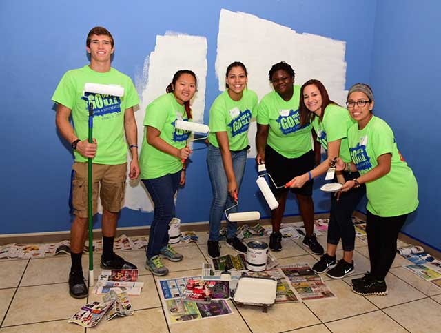 Volunteers painted a room at the Quality Life Center.