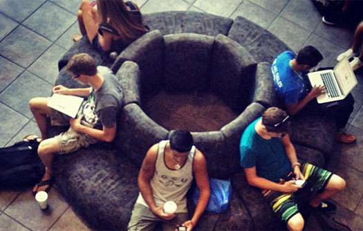 Students sitting on circular couch studying