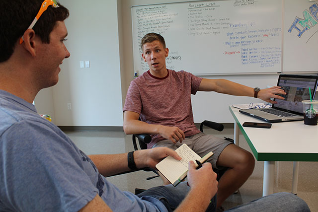 Runway student Jakub Adamowicz, right, working with mentor Scott Kelly.