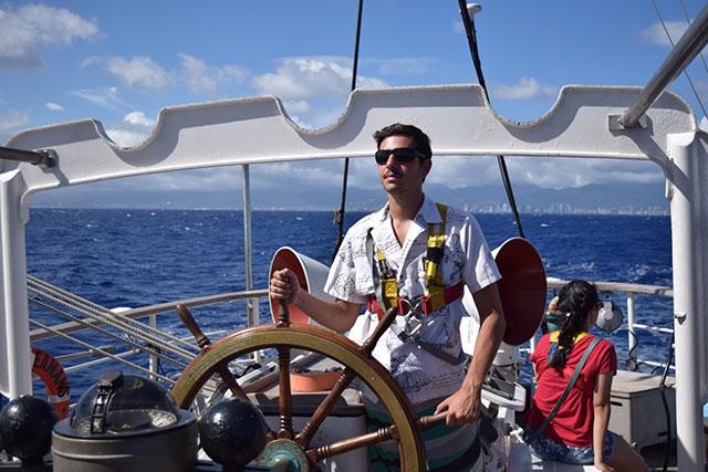 Alex Miranda at the helm of the SSV Robert C. Seamans.