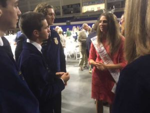 Rachel Smith, Miss Florida Citrus 2017 and a University of Florida graduate student, talks with officers of the Florida Association of the Future Farmers of America in Alico Arena.
