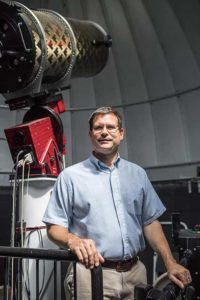 Photo shows FGCU professor Derek Buzasi in the Egan Observatory at FGCU