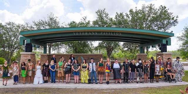 Students model apparel they fashioned from reprised materials at Eagles' Earth Day.