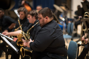 Photo shows FGCU student playing saxophone