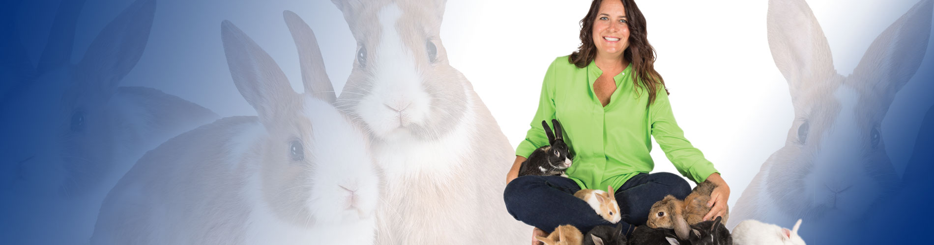 Photo of Beth with the bunnies she rescued