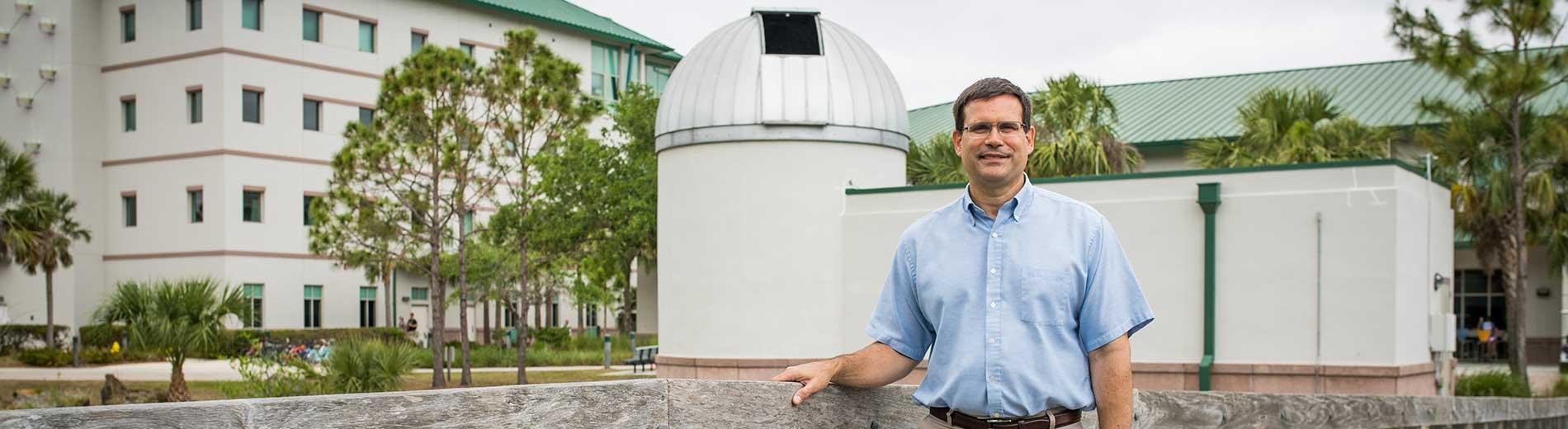 Photo shows FGCU professor Derek Buzasi