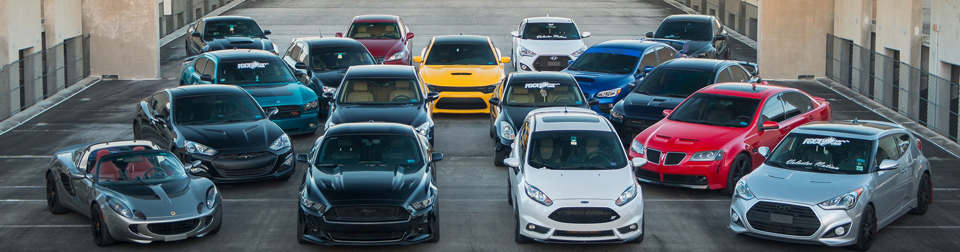 Photo of FGCU Car Club - cars parked on top of parking garage.