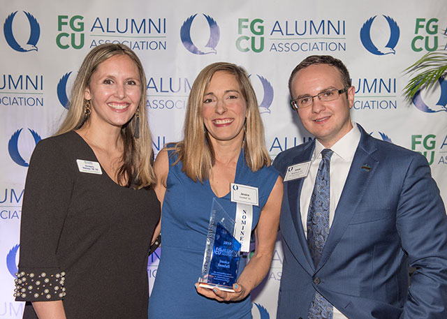 Photo shows FGCU Alumni Award winner