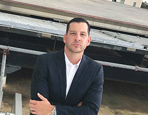 Andrew French manages building projects, competes on court