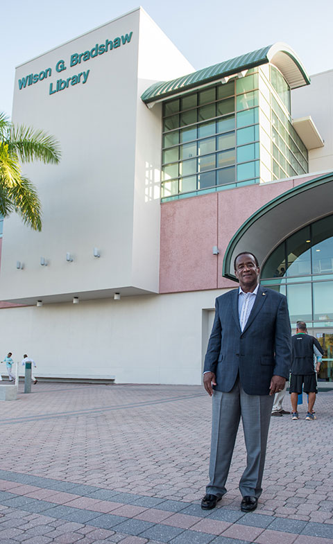Photo shows former FGCU president Bradshaw in front library