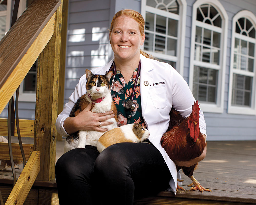 Photo of Meghan Schuman with chickens.
