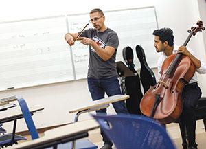 FGCU student cellist practicing with Asst. Prof. Jason Bahr.