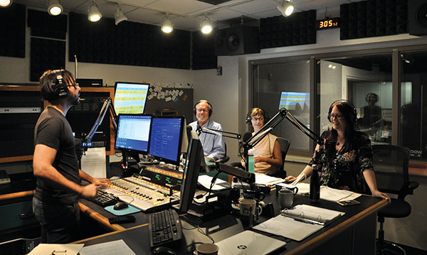 Photo of WGCU producers and guest talking on air