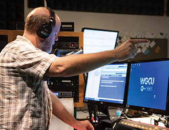 FGCU producer in booth during fundraising campaign.