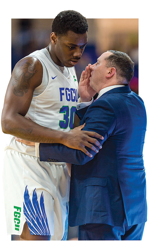 Photo of coach Michael Fly talks with Brian Thomas during a January game against Stetson.