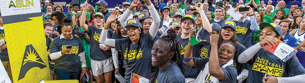 Photo of FGCU women's basketball team celebrating an ASUN win.
