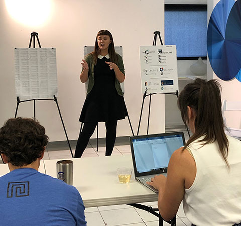 Photo hows FGCU student making a pitch