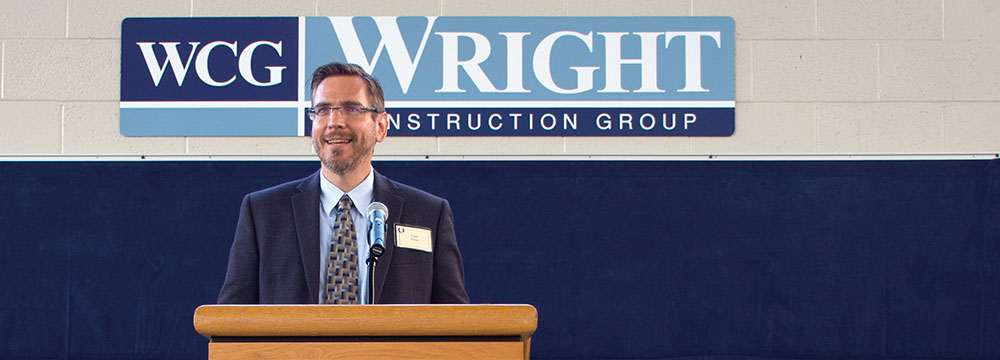 Photo of Fred Edman, President of Write Construction speaking about the future payoffs.