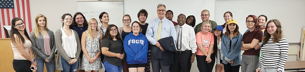 Photo of Henderson, FGCU student Hailey Countryman and Visiting Assistant Professor Peter Ndiangui.
