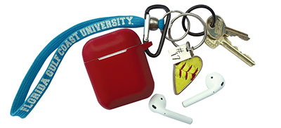 Photo of keys for objects of affection articls - with red earbud case.