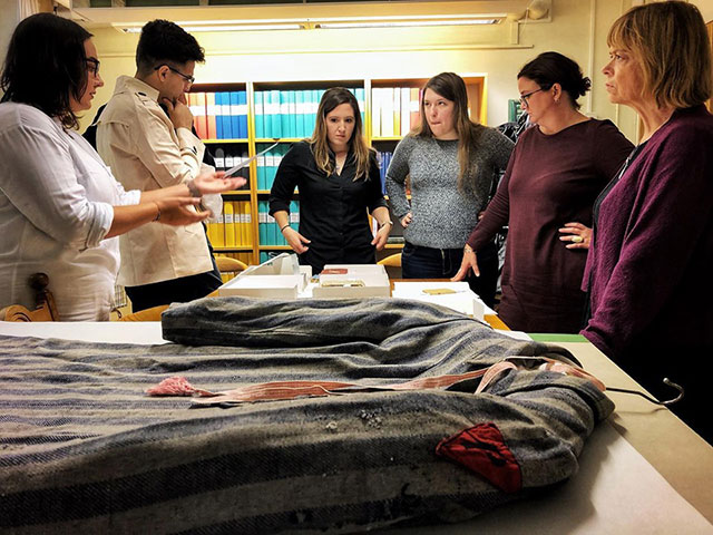 Photo shows FGCU students looking at historical artifacts