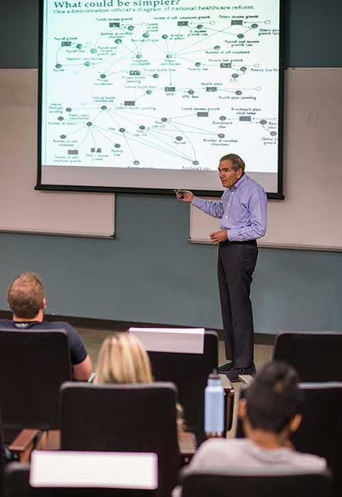Photo shows Jim Nathan teaching