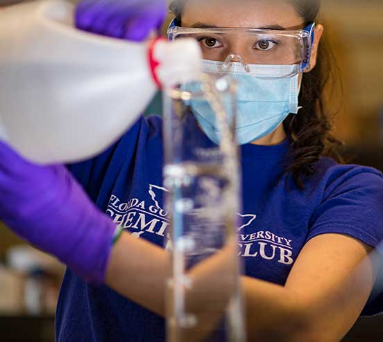 photo shows student making sanitizer