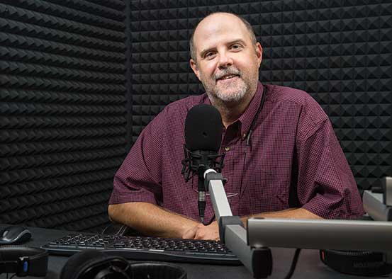Photo shows Podcaster Mike Kiniry