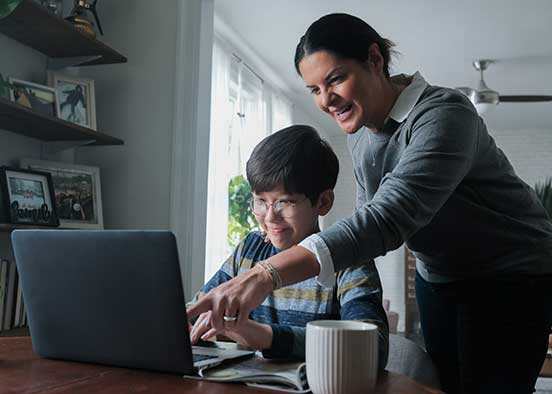Image shows child with mom pointing at laptop