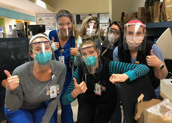 Photo shows healthcare workers wearing face shields