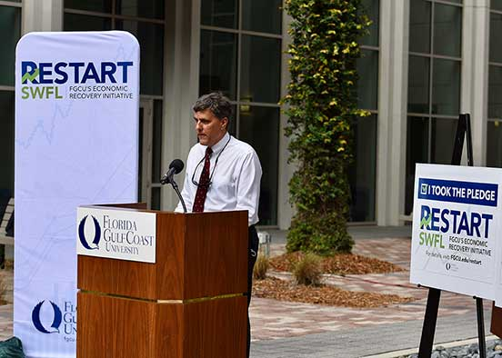 Photo shows FGCU dean