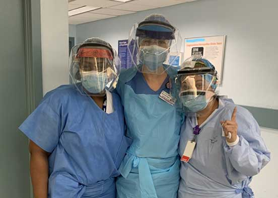 Photo shows nurses in personal protection equipment