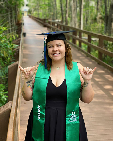 Photo shows FGCU graduate