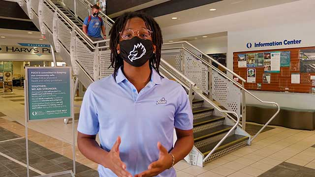 """Photo shows Gervais Baptiste, a finance and supply chain management major, discusses the importance of wearing a mask in one of the """"Protect The Nest"""" campaign videos."""