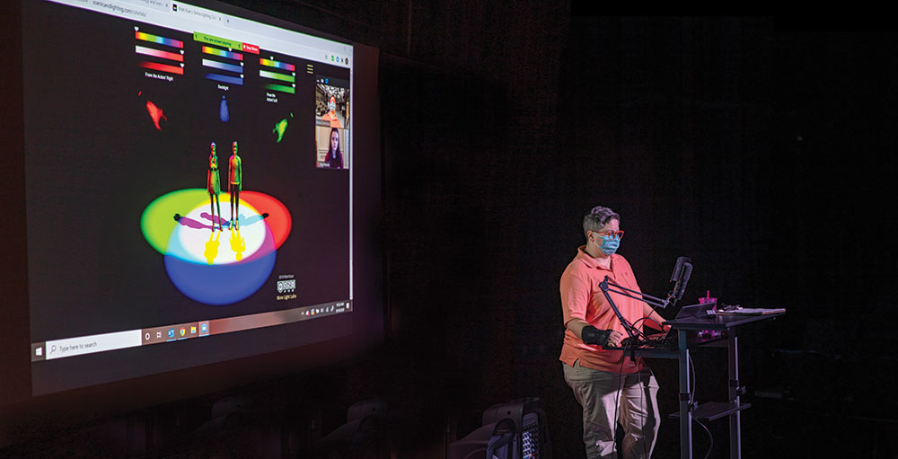 Professor Anne Carncross uses lighting software to teach in a socially distanced classroom and online.