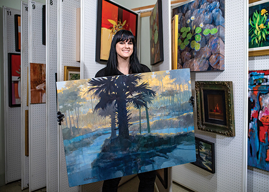 photo shows woman with painting