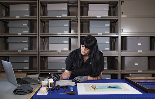 Caitlin Rosolen, '17, keeps track of the university's donated artwork.