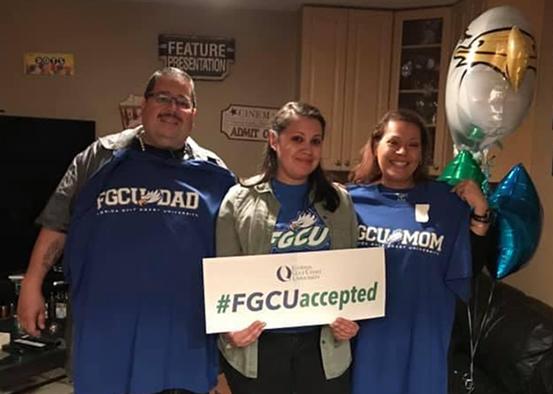 Photo shows FGCU student with parents