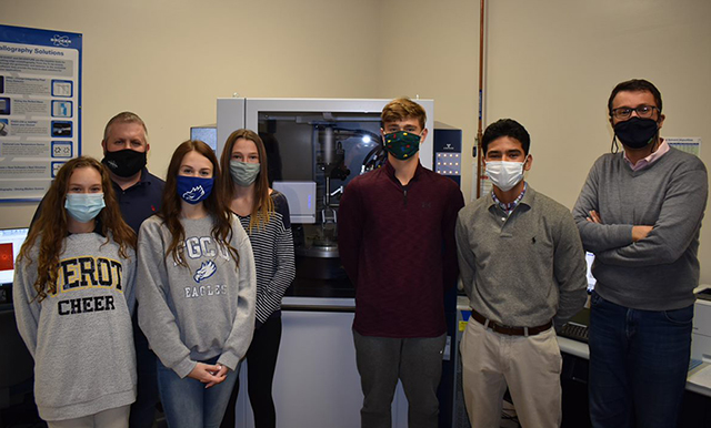 photo shows FGCU faculty with students in lab