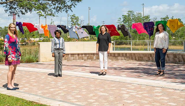 Photo shows FGCU faculty with clothesline