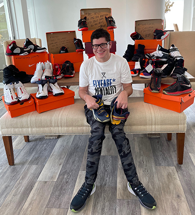 Photo shows FGCU alumnus with shoes
