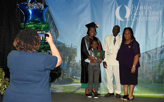 Photo shows FGCU graduate with guests