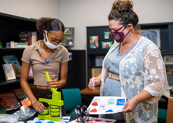 Photo shows FGCU faculty member and student